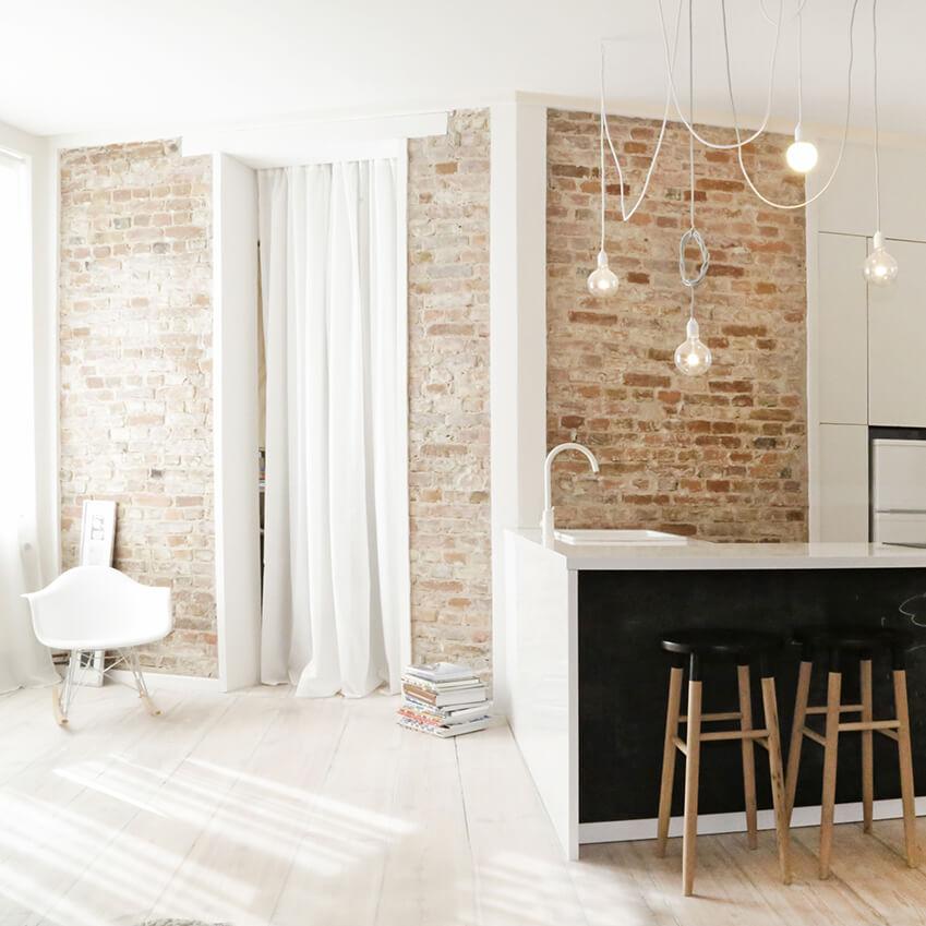 Découvrez la jolie décoration de cet appartement minimaliste, de style design et naturel. Trouvez plus d'inspiration dans le reste de l'article !